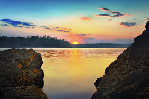 Sunset Between The Rocky Shore Poster