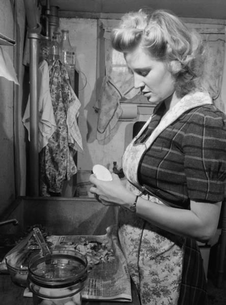 Young Women Peeling Potatoes Poster