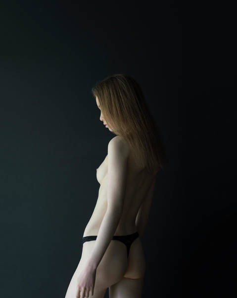 Girl In Front Of Black Wall Poster
