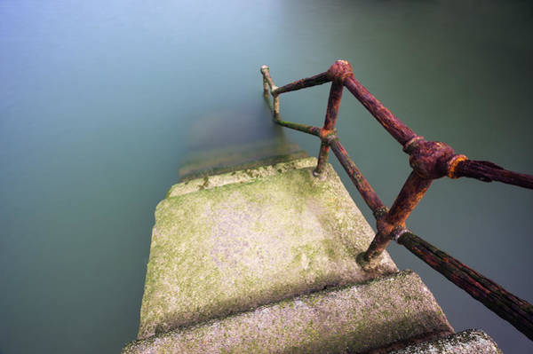 Rusty Handrail Going Down On Water Poster