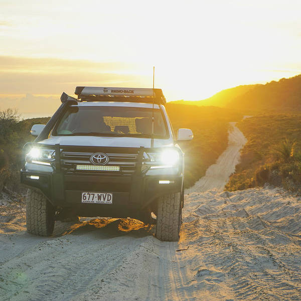 4wd Car Explores Sand Track In Early Morning Light Poster
