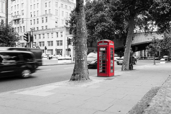A Single Red Telephone Box On The Street Bw Poster
