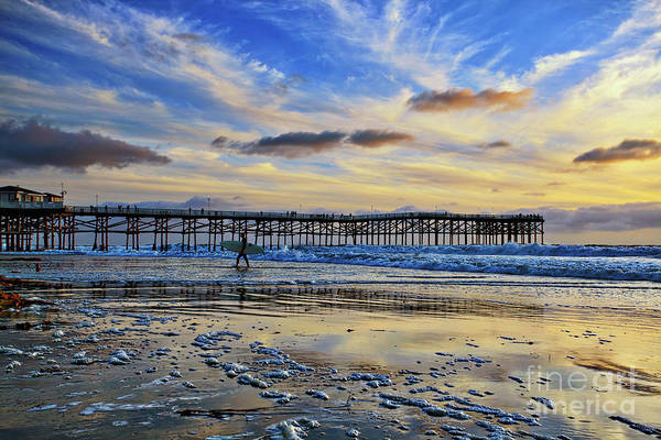 A Surfer Heads Home Under A Cloudy Sunset At Crystal Pier Poster