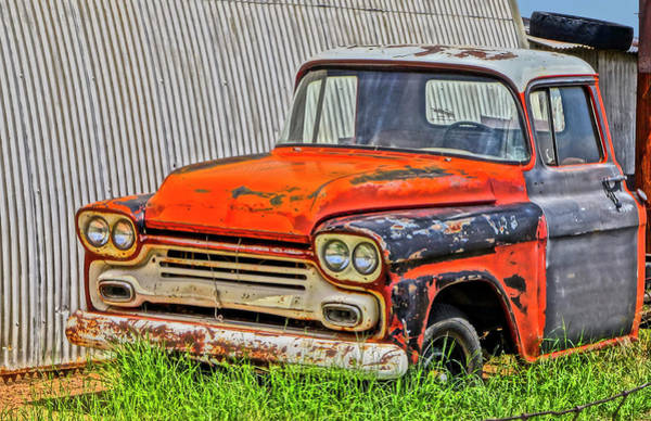 An Old Chevy Pickup Truck In A Junkyard  Poster