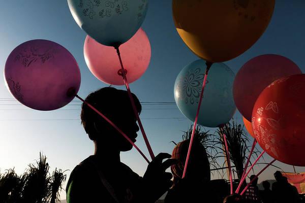 Balloon Seller At Pushkar Poster