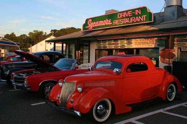 Classic Red Car In Front Of The Sycamore Poster