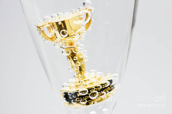 Closeup Of Small Trophy In Champagne Flute. Gold Colored Award I Poster