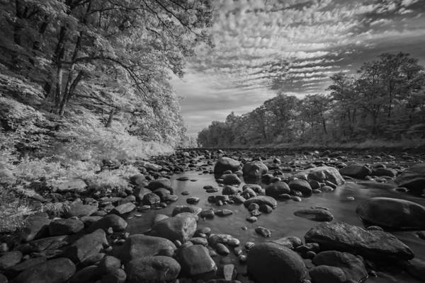 Clouds Over The River Rocks Poster