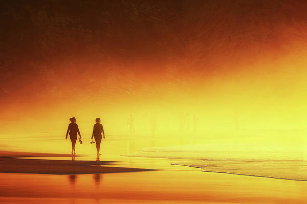 Couple Of Women Walking On Beach Poster