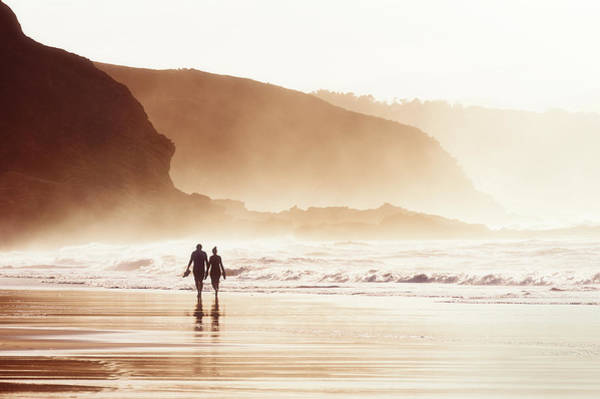 Couple Walking On Beach With Fog Poster