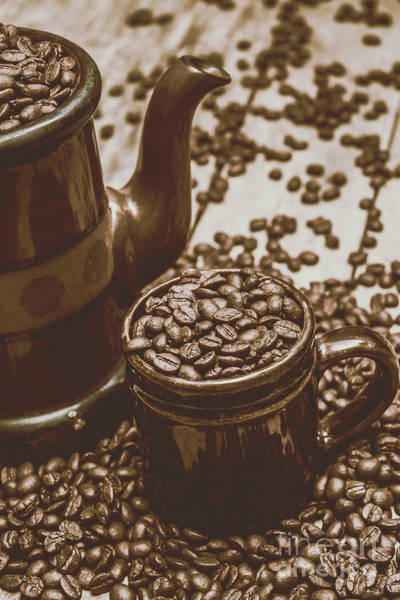 Cup And Teapot Filled With Roasted Coffee Beans Poster