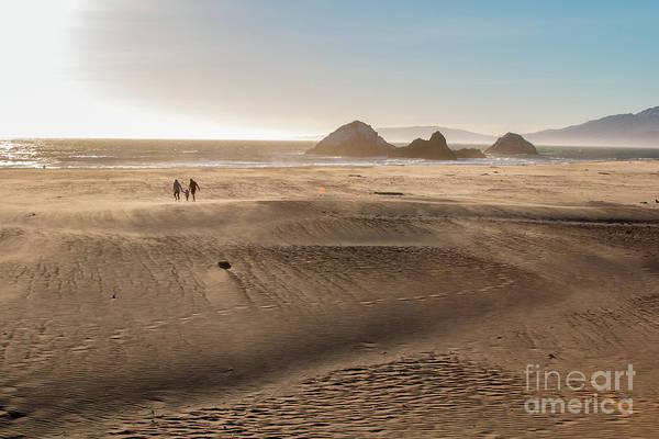 Family Walking On Sand Towards Ocean Poster