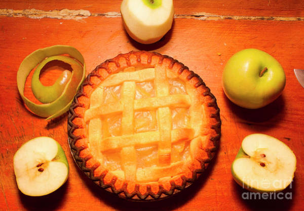 Freshly Baked Pie Surrounded By Apples On Table Poster
