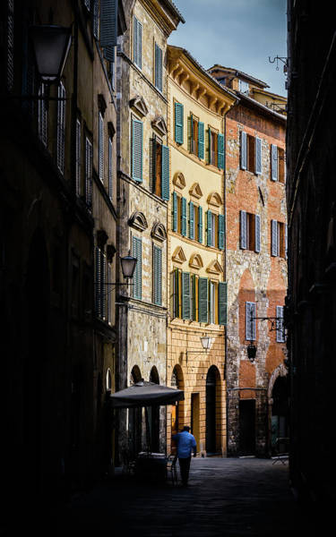 Man Walking Alone In Small Street In Siena, Tuscany, Italy Poster