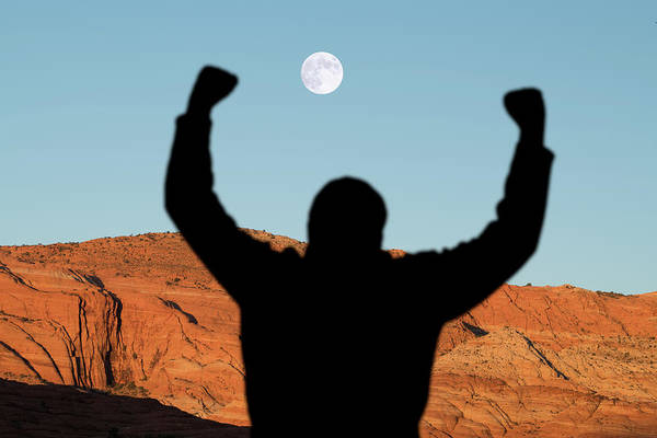 Man With Raised Arms In Desert Canyon Poster