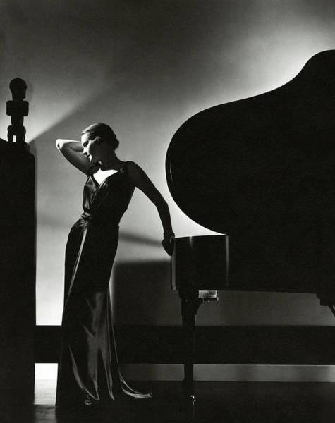 Margaret Horan Posing Beside A Piano Poster