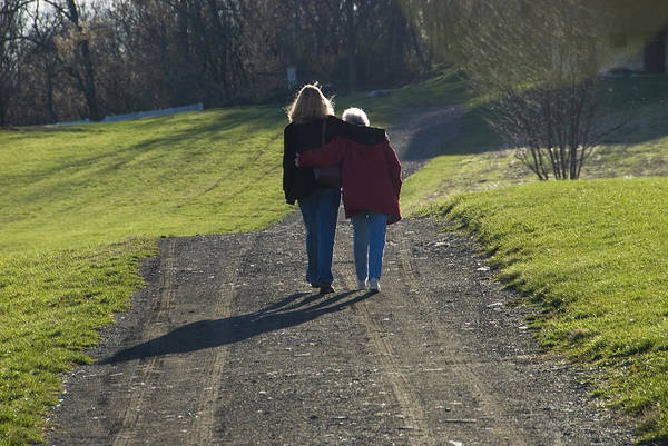 Mother And Daughter Arm In Arm Walking Poster