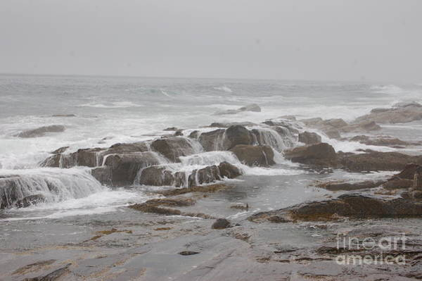 Ocean Waves Over Rocks Poster