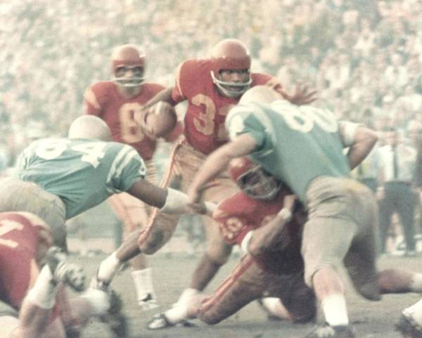 Oj Simpson Carrying The Ball Against Ucla Poster