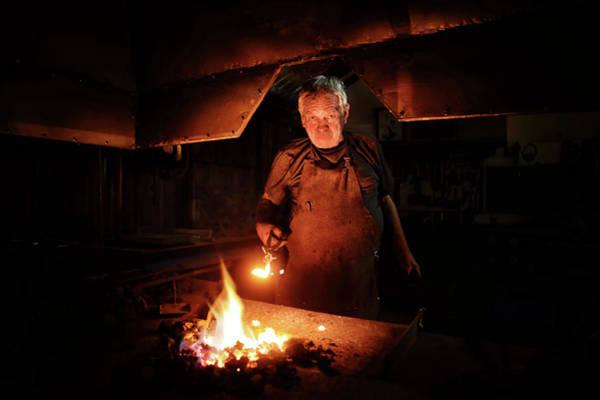 Old-fashioned Blacksmith Heating Iron Poster