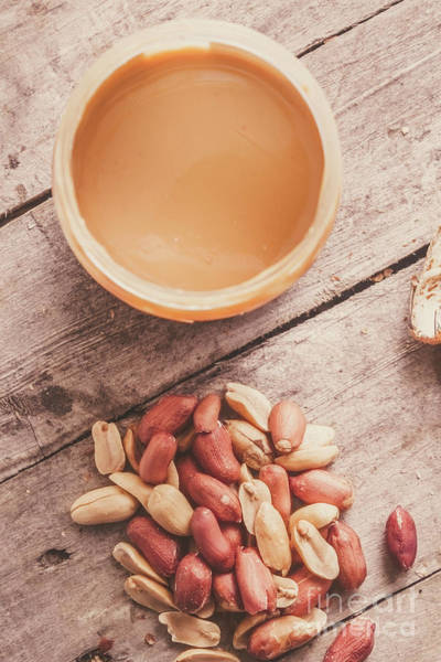 Peanut Butter Jar With Peanuts On Wooden Surface Poster