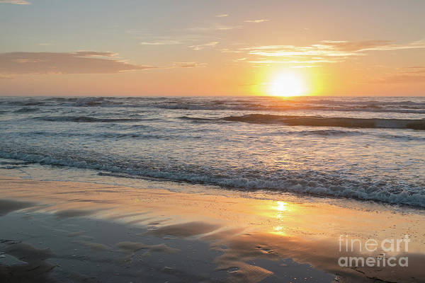 Rising Sun Reflecting On Wet Sand With Calm Ocean Waves In The B Poster