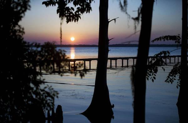 Riverside Sunset Poster