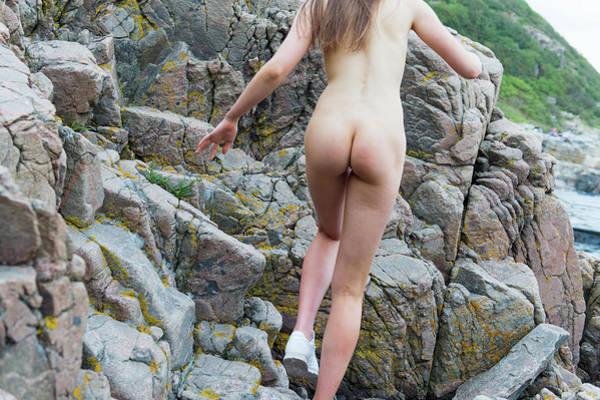 Running Nude Girl On Rocks Poster