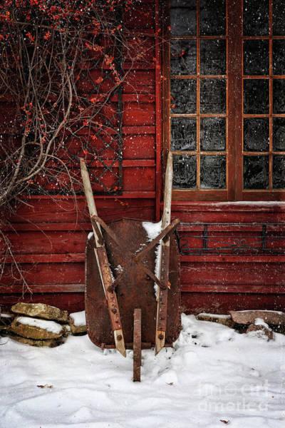 Rusty Wheelbarrow Leaning Against Barn In Winter Poster