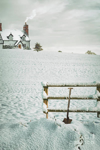 Spade Leaning Against Fence In The Snow Poster