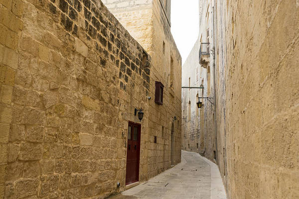 The Silent City - Big Walls Closing In And An Inviting Red Door In Mdina Malta Poster