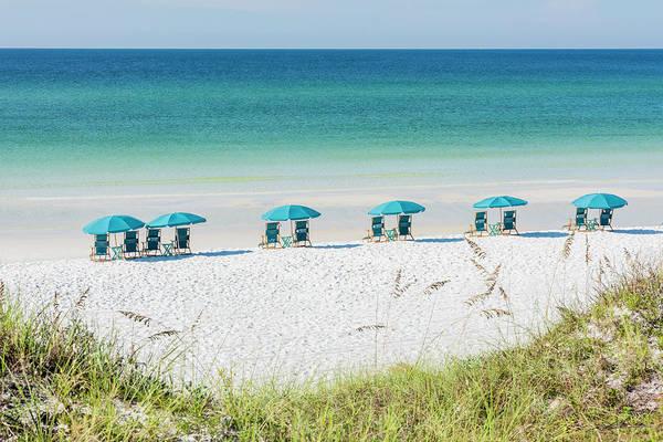 Umbrellas Await On The Beach Poster
