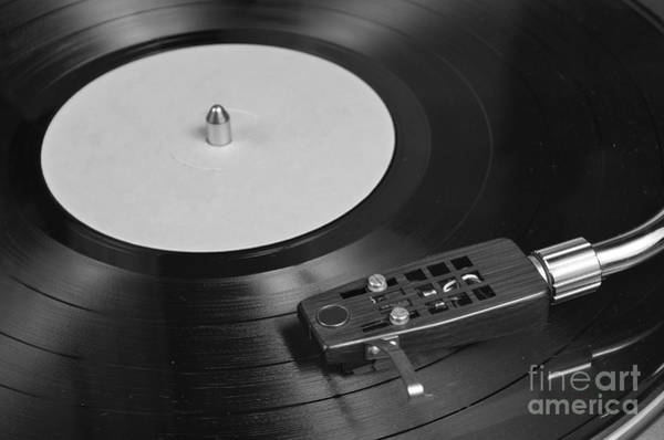 Vinyl Record Playing On A Turntable Overview Poster