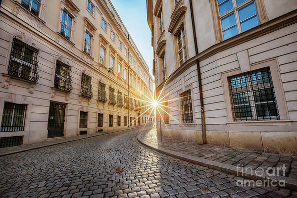 winter sun between two buildings in Vienna Poster