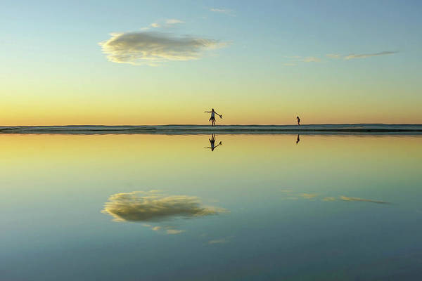 Woman And Cloud Reflected On Beach Lagoon At Sunset Poster