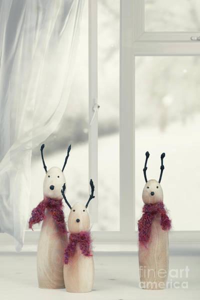 Wooden Reindeer Sitting In The Window Poster