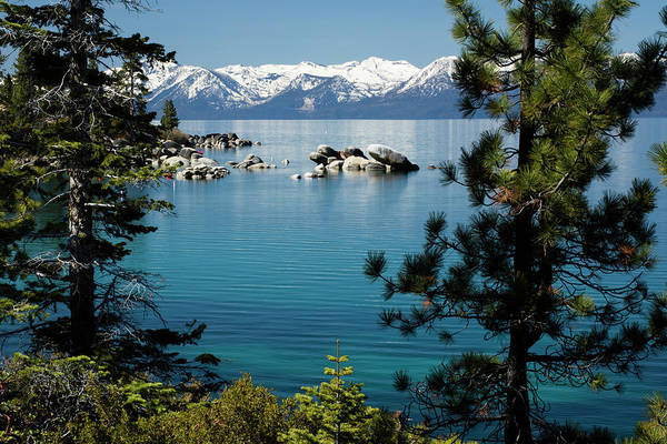 Rocks In A Lake With Mountain Range Poster