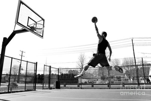 A Young Basketball Player Flying Poster