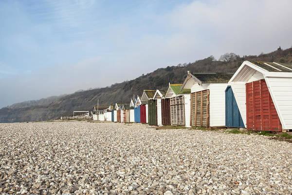 Beach Huts At Lyme Regis, Dorset Poster
