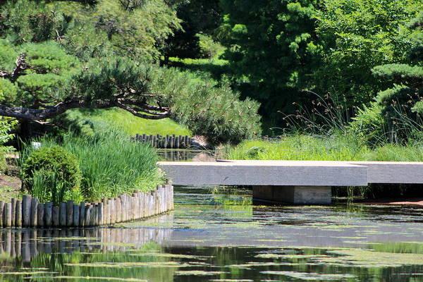 Bridge Over Pond In Japanese Garden Poster