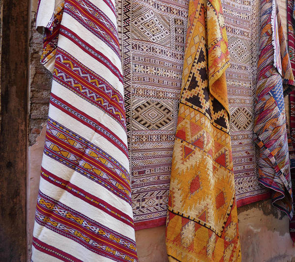 Bright Colored Patterns On Throw Rugs In The Medina Bazaar  Poster