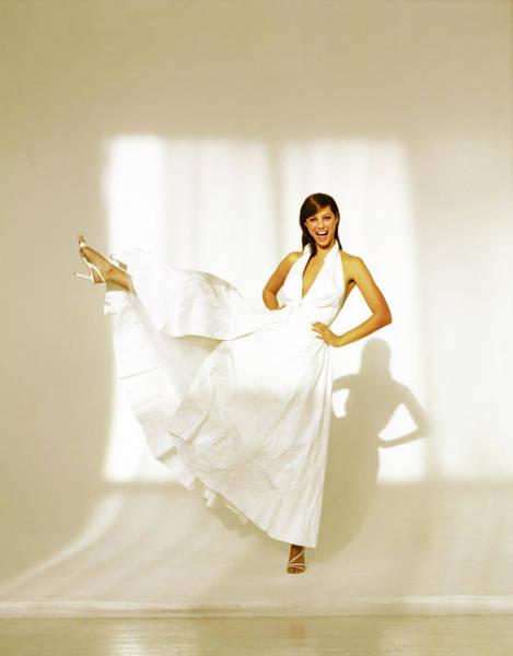 Christy Turlington Wearing A White Paper Dress Poster