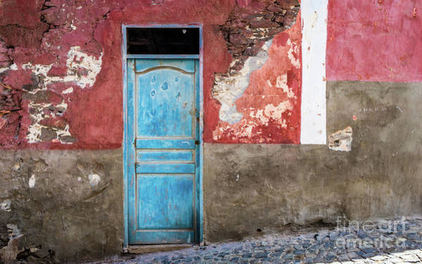 Colorful Wall With Blue Door Poster