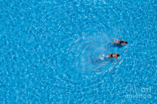 Couple Girls Swim In The Pool At The Poster