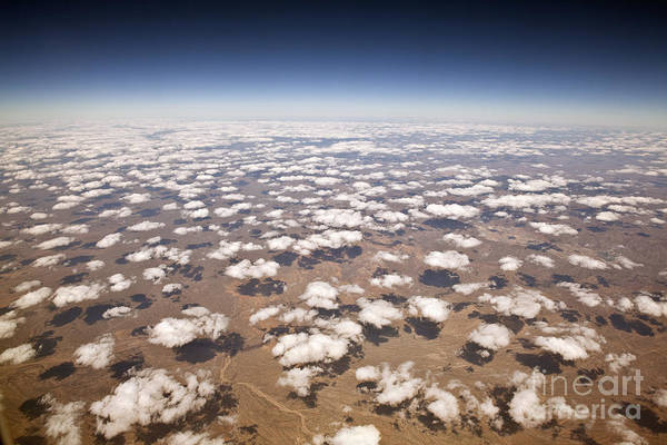 Decorative Clouds Over The Arid Deserts Poster