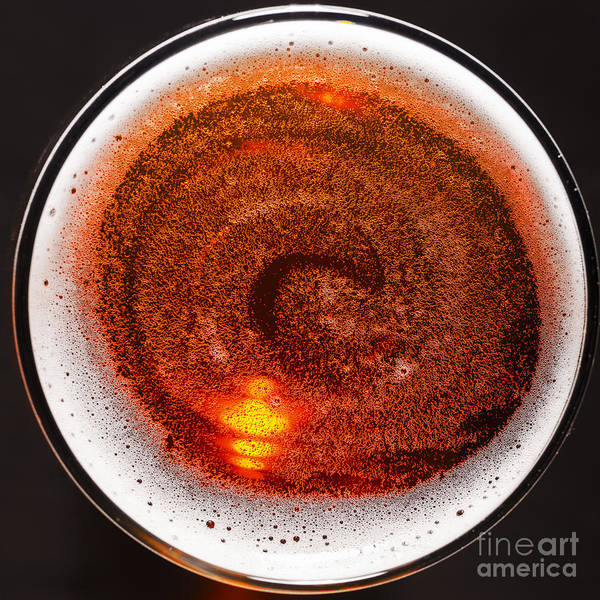 Glass Of Fresh Lager Beer On Black Table Poster