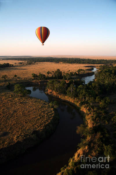 Hot Air Balloon Hovers Over The Winding Poster
