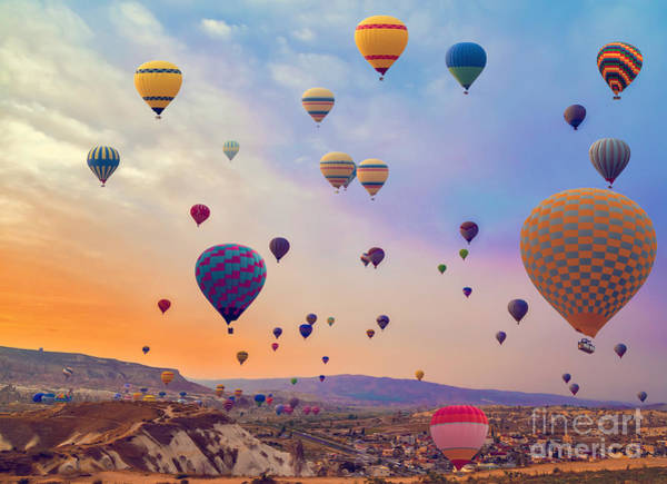 Hot Air Balloons Flying Over Mountains Poster