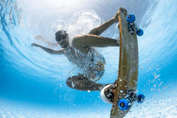 Man Skateboarding Underwater In The Poster
