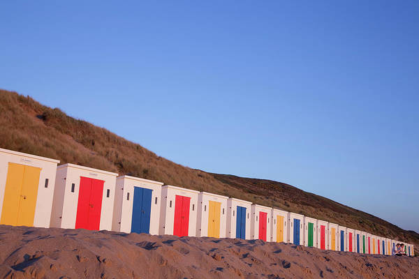 Multi-coloured Beach Huts On Woolacombe Poster